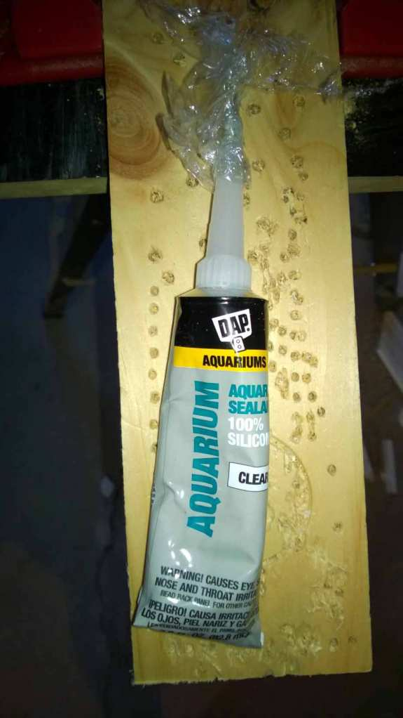 Next, you will need aquarium silicone, which dries non-toxic. For those with hot glue guns, those will work as well.