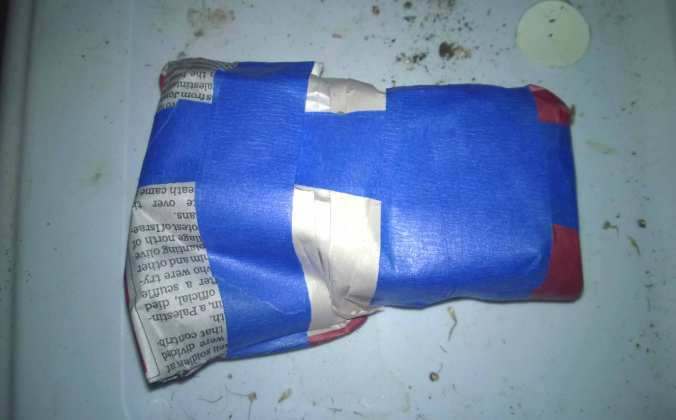 For extra protection, the bottles were wrapped and taped in newspaper.